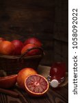 blood orange fruit in a wicker... | Shutterstock . vector #1058092022
