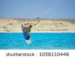 kitesurfer athlete performing... | Shutterstock . vector #1058110448