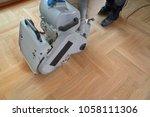 sanding hardwood floor with the ... | Shutterstock . vector #1058111306
