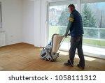 sanding hardwood floor with the ... | Shutterstock . vector #1058111312