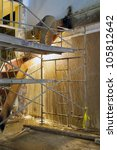 Stock photo construction worker with blow torch welding and cutting steel staircase 105812642