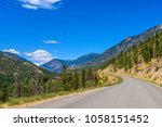 rocky mountains. mountain road... | Shutterstock . vector #1058151452