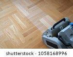 sanding hardwood floor with the ... | Shutterstock . vector #1058168996