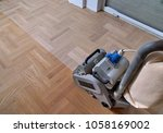 sanding hardwood floor with the ... | Shutterstock . vector #1058169002