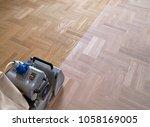 sanding hardwood floor with the ... | Shutterstock . vector #1058169005