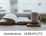 enjoying cold rainy day indoors | Shutterstock . vector #1058191172