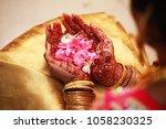 bride holding flower  indian... | Shutterstock . vector #1058230325