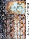 close up of rusted metal door ...   Shutterstock . vector #1058272088