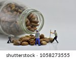 concept  small workers working... | Shutterstock . vector #1058273555