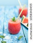 fresh watermelon smoothie in...   Shutterstock . vector #1058343455