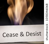 Small photo of Cease and Desist sign and fire as a warning concept.