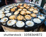 selling street food at local... | Shutterstock . vector #1058364872