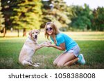 young girl plaing with her... | Shutterstock . vector #1058388008