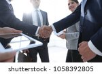 employees look at the handshake ... | Shutterstock . vector #1058392805