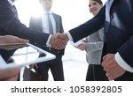 employees look at the handshake ... | Shutterstock . vector #1058392805