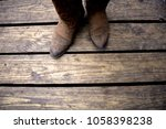 country western boots on wooden ... | Shutterstock . vector #1058398238