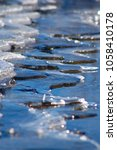 ice on the shore with... | Shutterstock . vector #1058410178