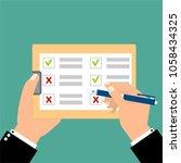 hand filling checklist on... | Shutterstock .eps vector #1058434325