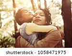 african american mother and her ...   Shutterstock . vector #1058471975