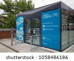 Small photo of Bury, Greater Manchester / GB - August 17 2013: Cycle hub enclosed and secure parking for bicycles outside Bury Interchange public transport hub