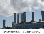 thick clouds of smoke from the... | Shutterstock . vector #1058488442