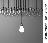 one hanging light bulb glowing... | Shutterstock . vector #1058511845