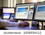 close up of a designer's hand... | Shutterstock . vector #1058554112