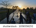 Small photo of Tourists enjoying at Asia's largest Tulip Garden during the sunset in Indian Administered Kashmir.