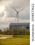 Reading, United Kingdom, 31th March 2018:- The Ecotricity wind turbine at Green Park Reading, a major landmark for traffic looking for Junction 11 on the M4 Motorway. - stock photo