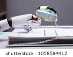 close up of a robotic hand... | Shutterstock . vector #1058584412
