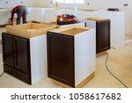 Stock photo kitchen remodel beautiful kitchen man assembling kitchen furniture 1058617682