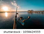 fishing after a long day at... | Shutterstock . vector #1058624555
