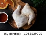 raw chicken legs on the wooden... | Shutterstock . vector #1058639702