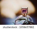 prfume. woman perfumes bottle....   Shutterstock . vector #1058657882
