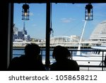 couple sitting in a cafe with a ... | Shutterstock . vector #1058658212