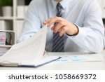 male hands hold documents with... | Shutterstock . vector #1058669372