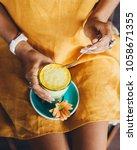 turmeric latte yellow drink | Shutterstock . vector #1058671355
