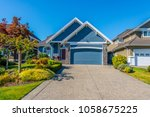 big custom made luxury house... | Shutterstock . vector #1058675225