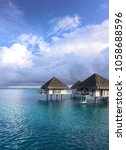 over the water bungalows in...   Shutterstock . vector #1058688596