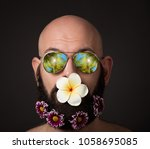 unshaven man with beard with... | Shutterstock . vector #1058695085