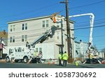 Small photo of Utility workers use auger drill digger to double up telephone poles - Revere, Massachusetts USA - March 26, 2018