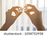 two hands of businessmen help...   Shutterstock . vector #1058752958