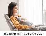young pregnant woman resting in ... | Shutterstock . vector #1058779802