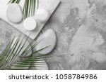spa stones and leaves on grey... | Shutterstock . vector #1058784986