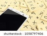 smartphone and arithmetic | Shutterstock . vector #1058797406