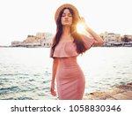 beautiful brunette young woman... | Shutterstock . vector #1058830346