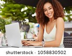 gorgeous smiling female enjoys... | Shutterstock . vector #1058830502