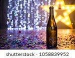 an open bottle of champagne on... | Shutterstock . vector #1058839952