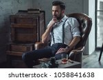 handsome pensive man is... | Shutterstock . vector #1058841638