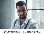 portrait of handsome confident... | Shutterstock . vector #1058841752